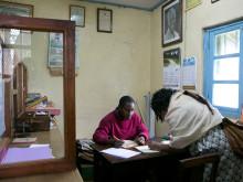 Executive secretary Chetus Kessy of the Kirua Vunjo East PS in his office.